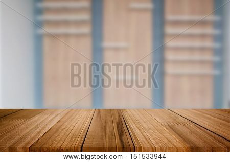 wooden table and Old brown empty shelf on wooden wall background for product display montage.