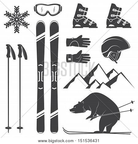 Set of skiing equipment silhouette icons. Set include skis, mountain, bear, gloves, goggles, helmet and snowflake. Winter equipment icons for family vacation, activity or travel. For logo design, patches, seal, logo or badges.