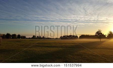 misty morning shows a pylon peeking through