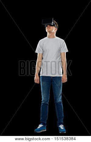 3d technology, virtual reality, entertainment, cyberspace and people concept - happy young man with virtual reality headset or 3d glasses looking up