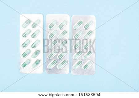 Three Blisters Full With Green Capsules