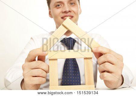 Inventor.  Businessman building tower of wooden blocks