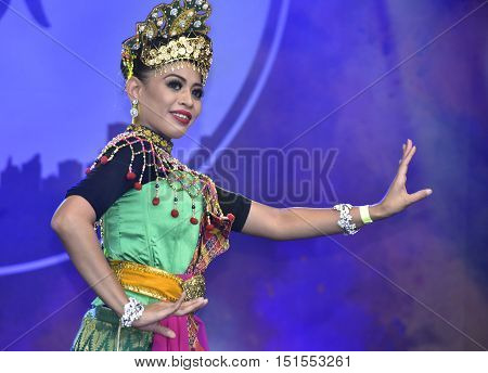 LONDON - SEPTEMBER 24: A Malaysian cultural dancer performing the Mak Yong Dance at the Malaysia Fest 2016 in Trafalgar Square, London, UK, SEPTEMBER 24, 2016. The Festival is now in its 7th Year.