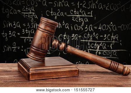 Judge's gavel with sound block on school blackboard background
