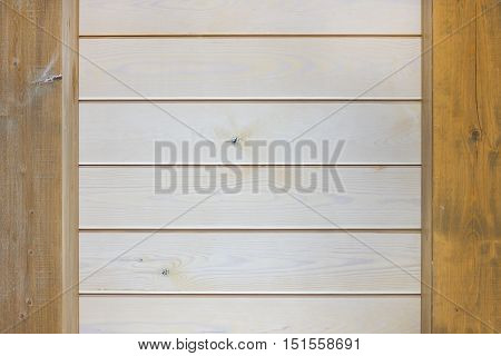 Background image of two vertical wooden piles with horizontal wooden beams.