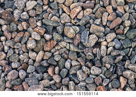 Abstract background with decorative floor pattern of sea gravel stones, Gravel texture