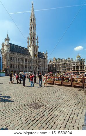 Brussels, Belgium - April 5, 2008:  Tourists Walk In Front Of The Town Hall On Grand Place