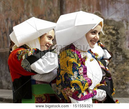 CAGLIARI, ITALY - May 1, 2014: 358 ^ Religious Procession of Sant'Efisio - Sardinia - group of beautiful girls in traditional Sardinian costume