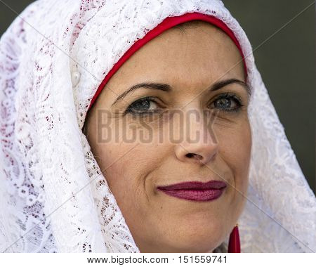 CAGLIARI, ITALY - May 1, 2015: 359 ^ Religious Procession of Sant'Efisio - Sardinia - portrait of a beautiful woman in traditional Sardinian costume