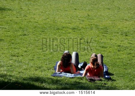 Girls Laying On A Meadow
