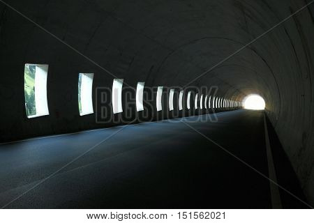 Road tunnel with light at the end