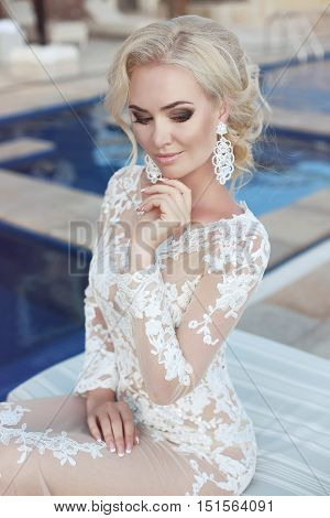 Wedding Portrait Of  Blond Bride Woman With Makeup, Bridal Jewelry And Hairstyle. Beautiful Model We
