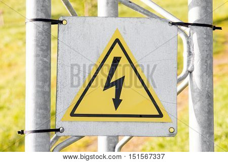 High voltage warning sign on metal construction