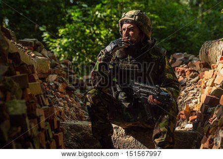 Soldier In The Barricade With The Gun