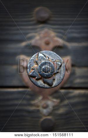 Rusty Iron Door Knob On Vintage Wooden Door