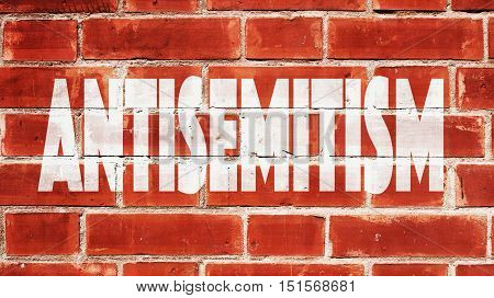 Antisemitism Written On A Red Brick Wall