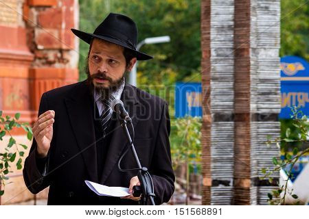Uzhgorod Ukraine - October 9 2016: Rabbi prays during the opening ceremony of the monument to local victims of the Holocaust on the square near the former synagogue.