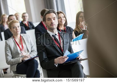 Business people attending seminar at convention center