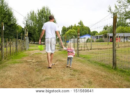 Father With Daughter Observing The Farmland Area. New Zealand
