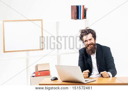 Smiling Programmer At Office Desk