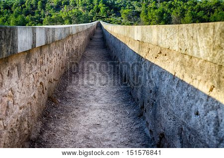 Inside view on roman aqueduct channel near Tarragona, summer Spain