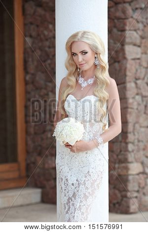 Beautiful Bride Portrait Holding Wedding Bouquet. Makeup And Hairstyle, Jewelry Model, Fashion Bride