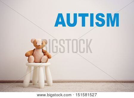Children autism concept. Children stool with toy on white wall background