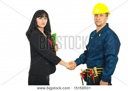 Business Woman And  Constructor Worker Deal