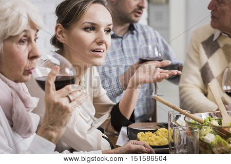 Woman Talking At The Dinner Table