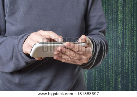 The cyber criminal person using a smart phone in deep web cyberspace. Selective focus.