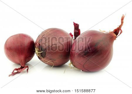 three red onions on a white background