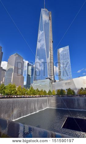 EW YORK NY USA 24 10 13: One World Trade Center or Freedom Tower of the new World Trade Center complex and National September 11 Memorial & Museum or 9/11 Memorial and 9/11 Memorial Museum