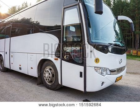 RUSSIA, YEKATERINBURG -August 3, 2016: Tourist Bus on Parking. Modern White Passenger Bus on Parking, Traveling by Bus