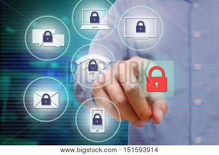 Businessman pressing red security lock button on virtual screens and transparent business technology internet network concept.