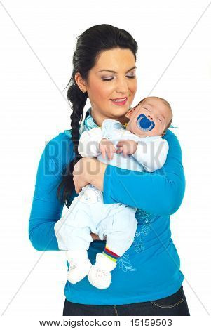 Happy Mother Holding Sleeping Baby Boy