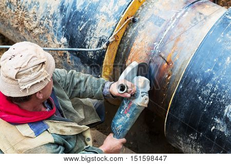 Odessa, Ukraine - October 11, 2016: Repair Of Heating Duct. The Workers, Welders Made By Electric We