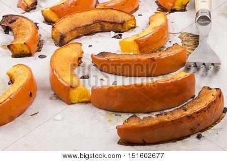 roasted hokkaido pumpkin slices on white kitchen paper with fork