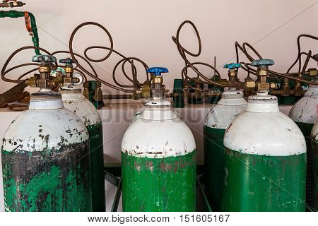 Close up many oxygen supply tanks in hospital