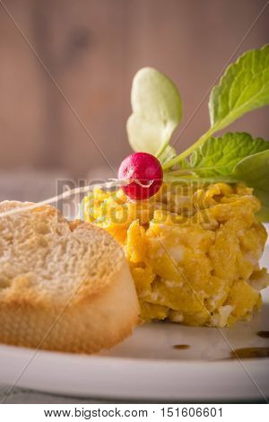 Ingle Portion Of Scrambled Eggs With Nice Small Radish