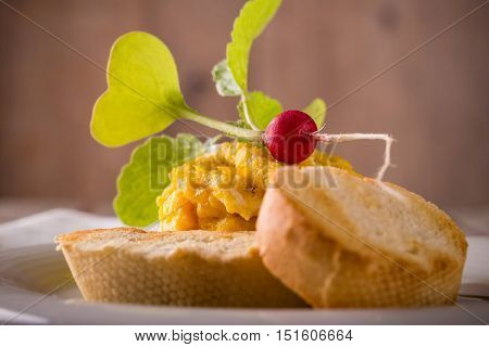 Young Red Radish On Scrambled Eggs With Pastry