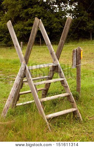 A stile is a ladder over a fence.
