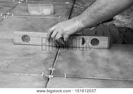 Renovation - Man construction worker laying floor tile