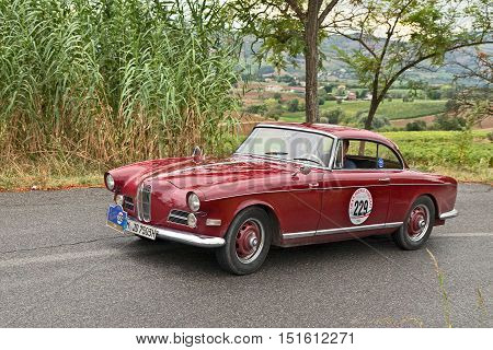 MELDOLA, FC, ITALY - SEPTEMBER 18: driver and co-driver on a German vintage car BMW 503 coupe' (1959) in classic car rally