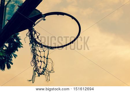 under view of old basketball hoop with copy space for text concept. vintage tone effect.