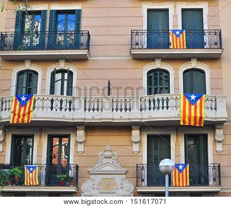 Houses of Barcelona with flags of Catalonia