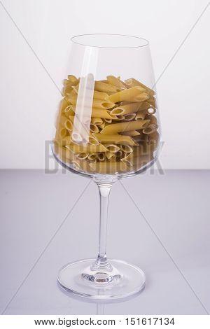 Italian Penne Rigate pasta in a glass