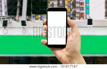 man showing a phone in a mall selling phones
