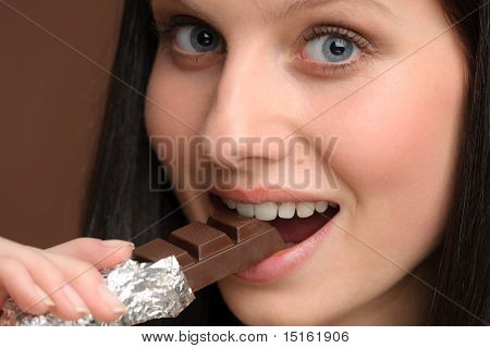 Chocolate - Close-up Young Woman Bite Piece