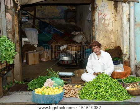 AHMEDABAD GUJARAT INDIA - JANUARY 30: Indian selling vegetables from carts in the street in the Ahmedad city in the Gujarat state in India Ahmedabad in January 30 2015
