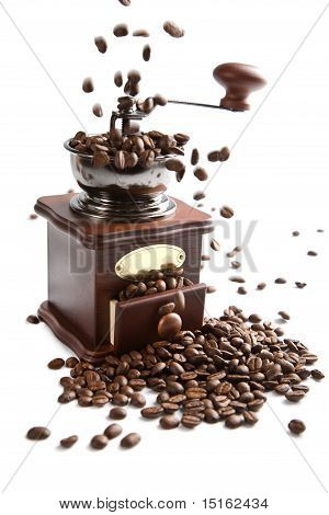 Coffee Beans Falling Into Grinder Isolated